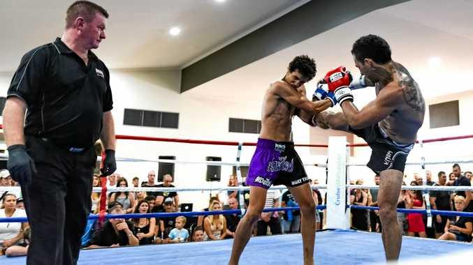 FIGHT NIGHT: Whitsunday's Tony Mulligan (right) got the crowd on their feet in a brutal muay thai battle against Townsville's Joseph Gabiloa.