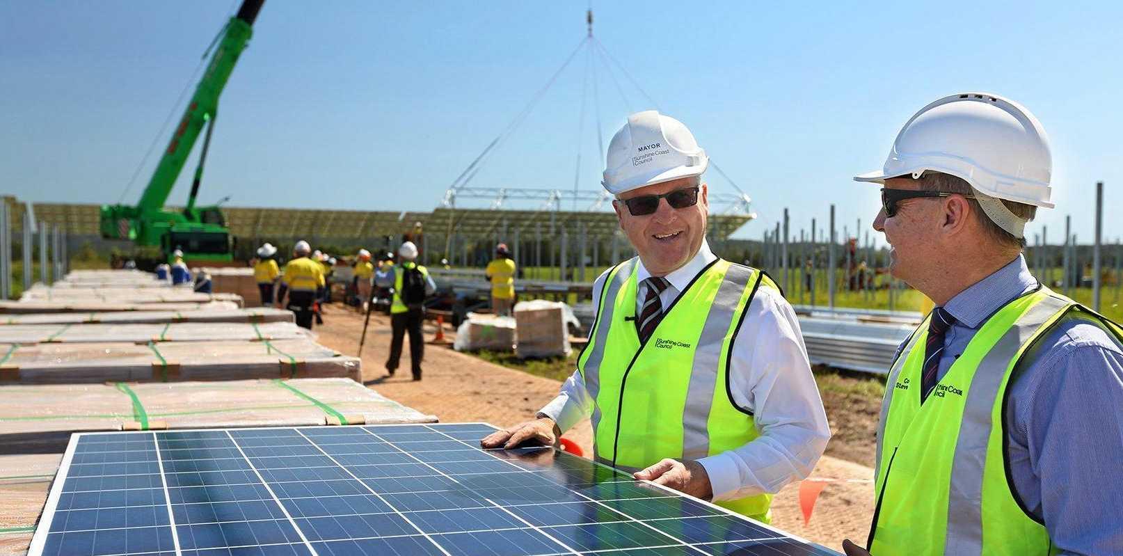 Construction at a Sunshine Coast solar farm at Valdora (Pictured: Sunshine Coast Mayor Mark Jamieson and Steve Robinson).