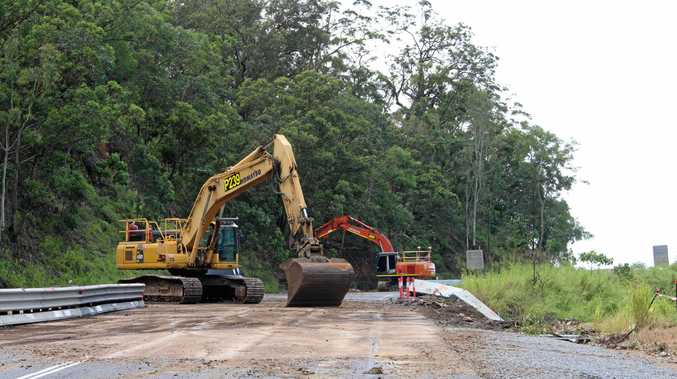Excavators work to clear the Eton range after Tropical Cyclone Debbie.