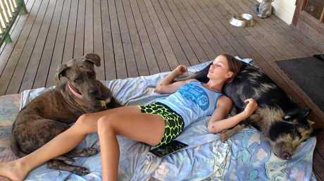 Skye Houliston with her pet pig and pet dog.