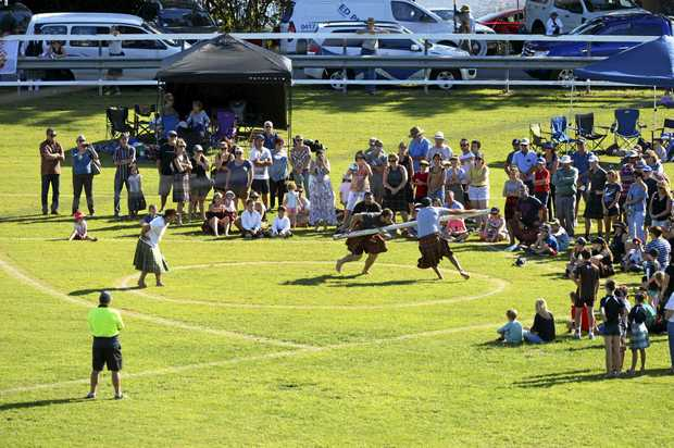 LAUNCH: Caber Tossing final at the 113th Maclean Highland Gathering at Maclean Showground on Saturday .