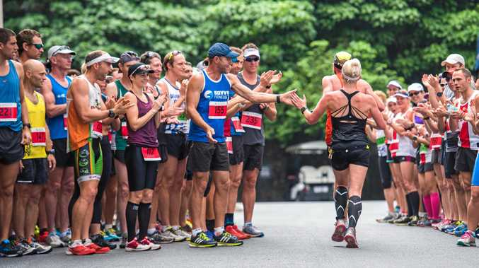 BIG EFFORT: Runners cheer each other on at the Hamilton Island Hilly Half Marathon last year.