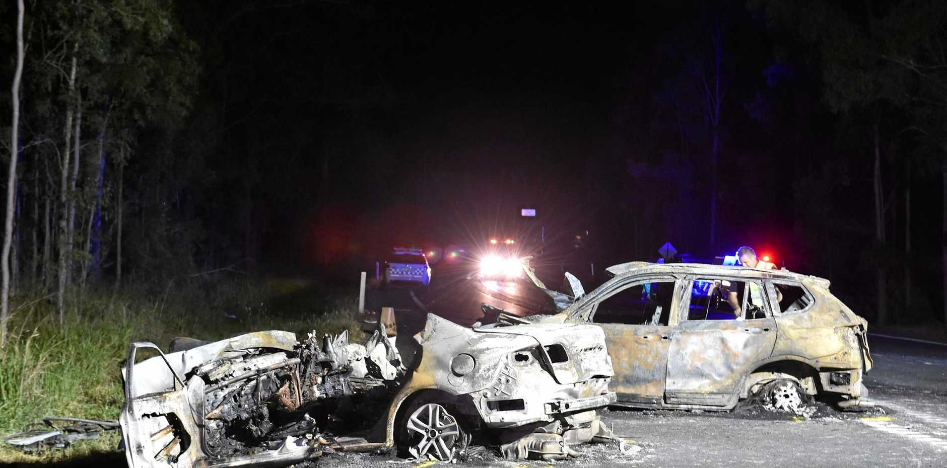 Crash investigators at the scene of the double fatality on the Bruce Hwy near Tiaro.