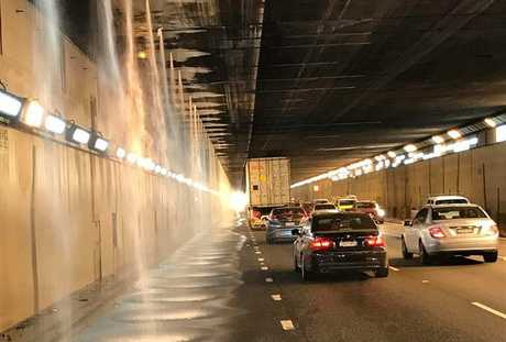 CHAOS: Peak-hour traffic chaos as an oversize load wipes out Sydney airport tunnel sprinkler system