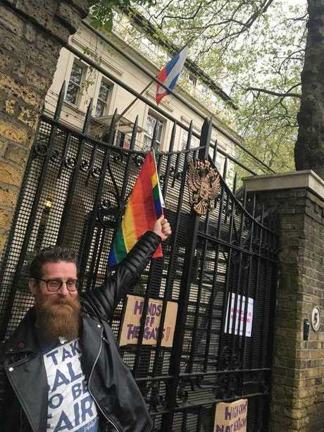 A man poses outside the Russian Embassy in London, following reports of alleged torture and murder of gay men in Chechnya