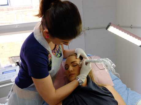 Beauty Effects owner June Warry gives customer Cheynee Wedrat perfect brows.