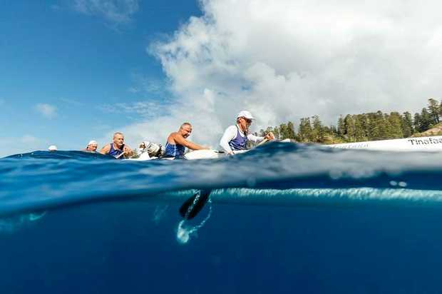 TOP FORM: The Noosa men's outrigger crew go for it at Norfolk island.