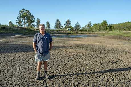 Anrew Gosbell stading in his dam where he has never seen it this dry.