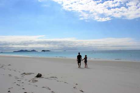 Chris Hemsworth and wife Elsa Pataky enjoy a walk along Whitehaven Beach, Queensland.
