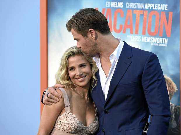 "Elsa Pataky, left, and Chris Hemsworth arrive at the Los Angeles premiere of ""Vacation\"" at the Regency Village Theatre on Monday, July 27, 2015. (Photo by Chris Pizzello/Invision/AP)"