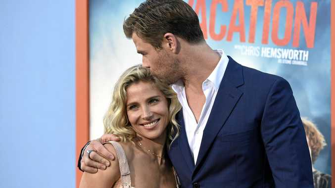 Elsa Pataky, left, and Chris Hemsworth arrive at the Los Angeles premiere of \
