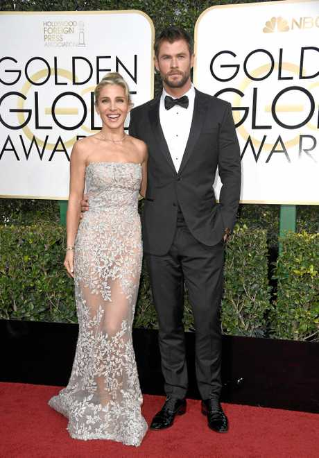 Elsa Pataky and Chris Hemsworth attend the 74th Annual Golden Globe Awards.