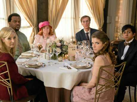 Lisa Kudrow, Craig Robinson, June Squibb, Stephen Merchant, Anna Kendrick and Tony Revolori in a scene from the movie Table 19.