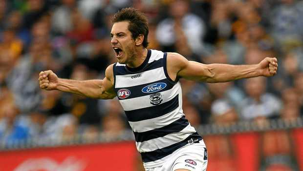 Daniel Menzel celebrates kicking a goal against the Cats on Monday.