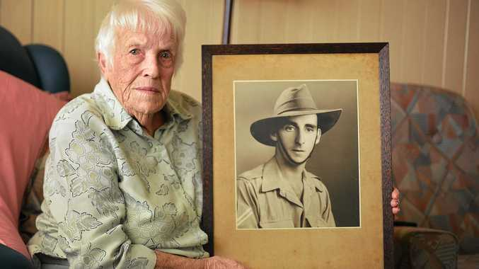 Lillian Brennan with a picture of her late husband Colin, who served in the Second World War.