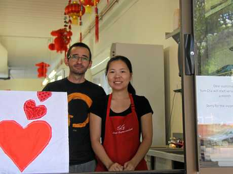 "Niall MacLeod and Liz Hung at SG Asian Supermarket, are open and ready for customers after the floods. ""We are waiting on a machine to come from and they we can once again sell dumplings,"" Ms Hung said."