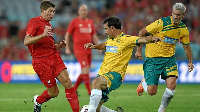 Steven Gerrard (left) is tackled by Tony Vidmar in the game between the Liverpool Legends and Australia Legends last year.