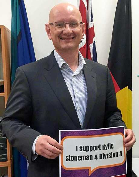 Photo of Shayne Neumann with a sign showing support for division four candidate Kylie Stoneman. Photo: Contributed