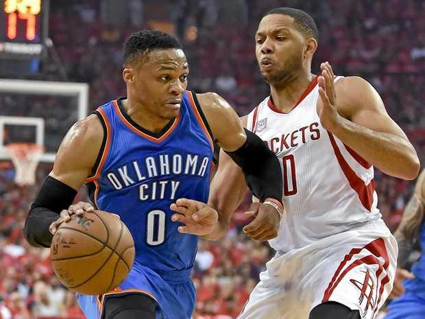 Oklahoma City Thunder guard Russell Westbrook drives past Houston Rockets guard Eric Gordon.