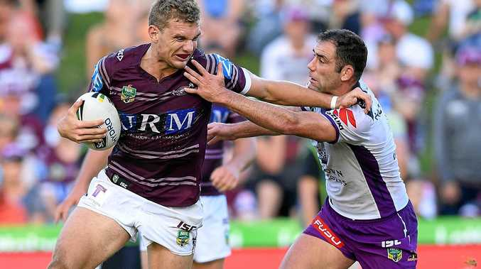 Tom Trbojevic of the Sea Eagles is tackled by Cameron Smith of the Storm.