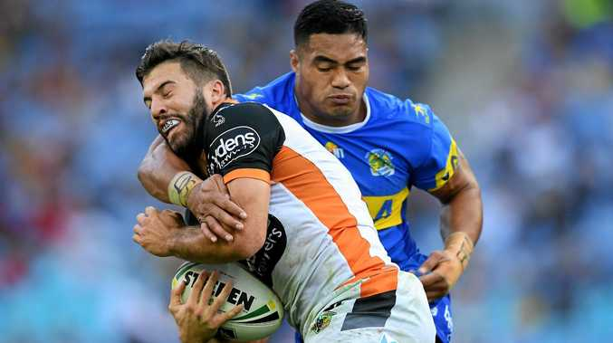 James Tedesco of the Tigers is tackled by Kirisome Auva'a of the Eels.