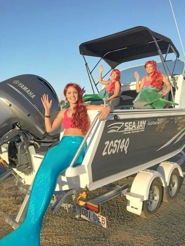 HOOKUP MERMAIDS: Eliza McGuire, Niamh Clements and Kaylee Steele in the Seajay 550 Trojan that's up for grabs at this year's Boyne Tannum HookUp.