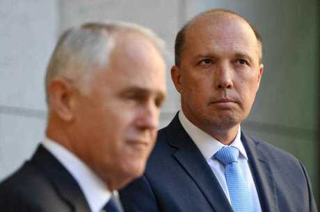 Australia's Prime Minister Malcolm Turnbull and Australia's Immigration Minister Peter Dutton speak during a press conference at Parliament House