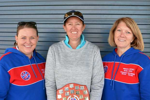 Dr Barbara O'Dea Memorial Trophy winner Karyn Byrne with Amelia Sutton (left) and Leanne Olsen (right) from Warwick netball.