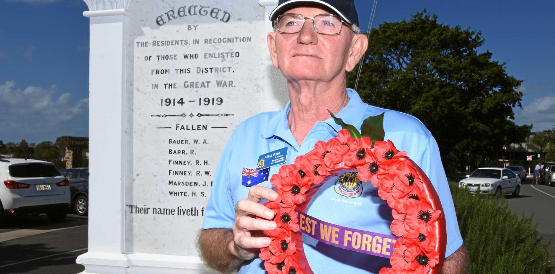 WE REMEMBER: Tewantin-Noosa RSL sub-branch president Mick Reid in front of the cenotaph.