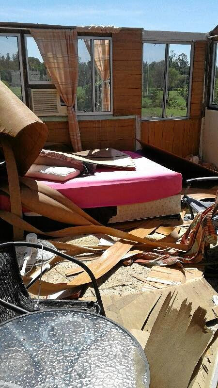 The roof of Gail and John Mossman's Miriam Vale home was torn off when a mini tornado swept through the small township on March 30.