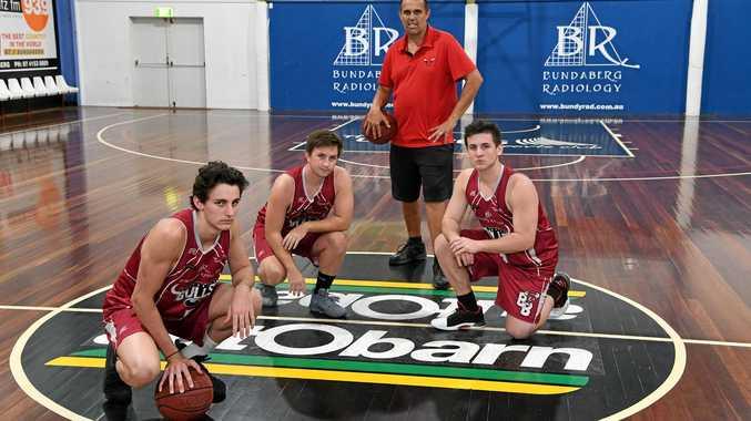 BASKETBALL: Bundaberg Bulls coach Mick Catlin with Ben Wright, Daniel Gardner and Shayne Mayes.