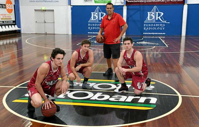 BASKETBALL: Bundaberg Bulls coach Mick Catlin with Ben Wright, Daniel Gardner and Shayne Mayes.