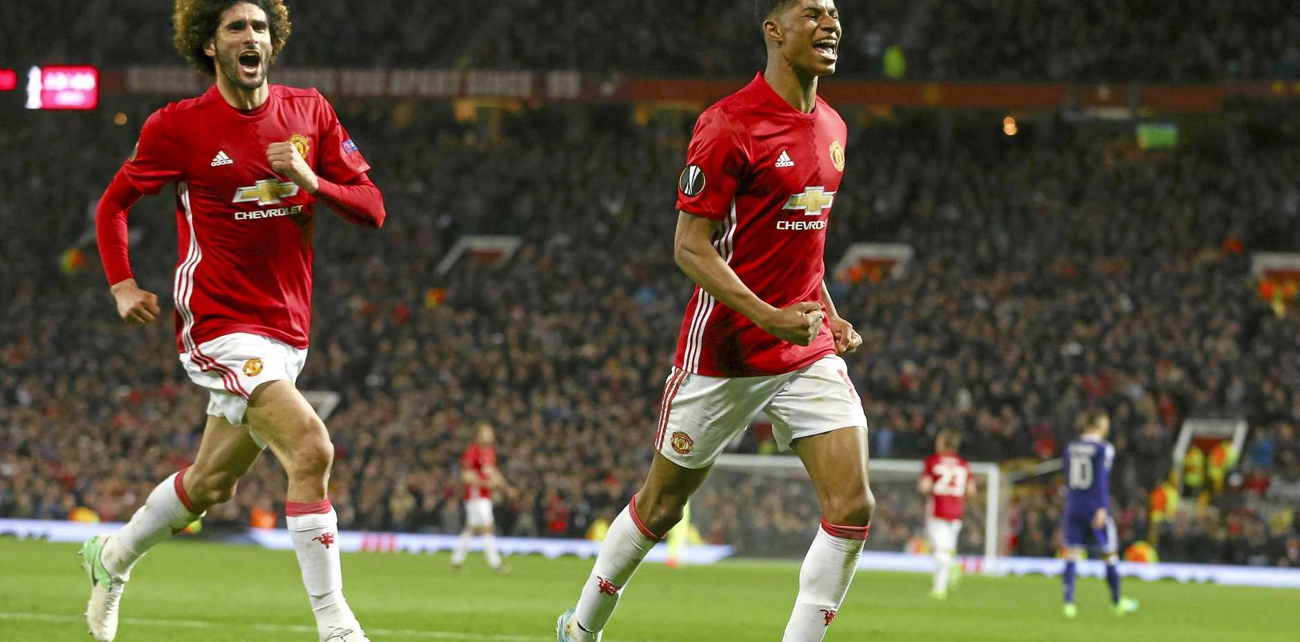 Manchester United's Marcus Rashford (right), with teammate Marouane Fellaini, celebrates his side's winner.