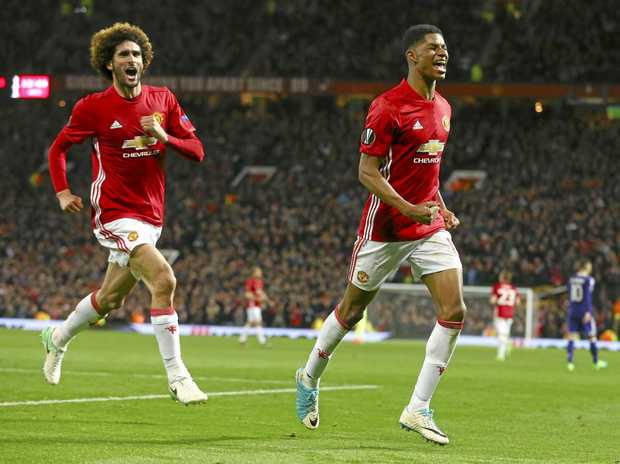 Manchester United's Marcus Rashford (right), with teammate Marouane Fellaini, celebrates his side's winner.