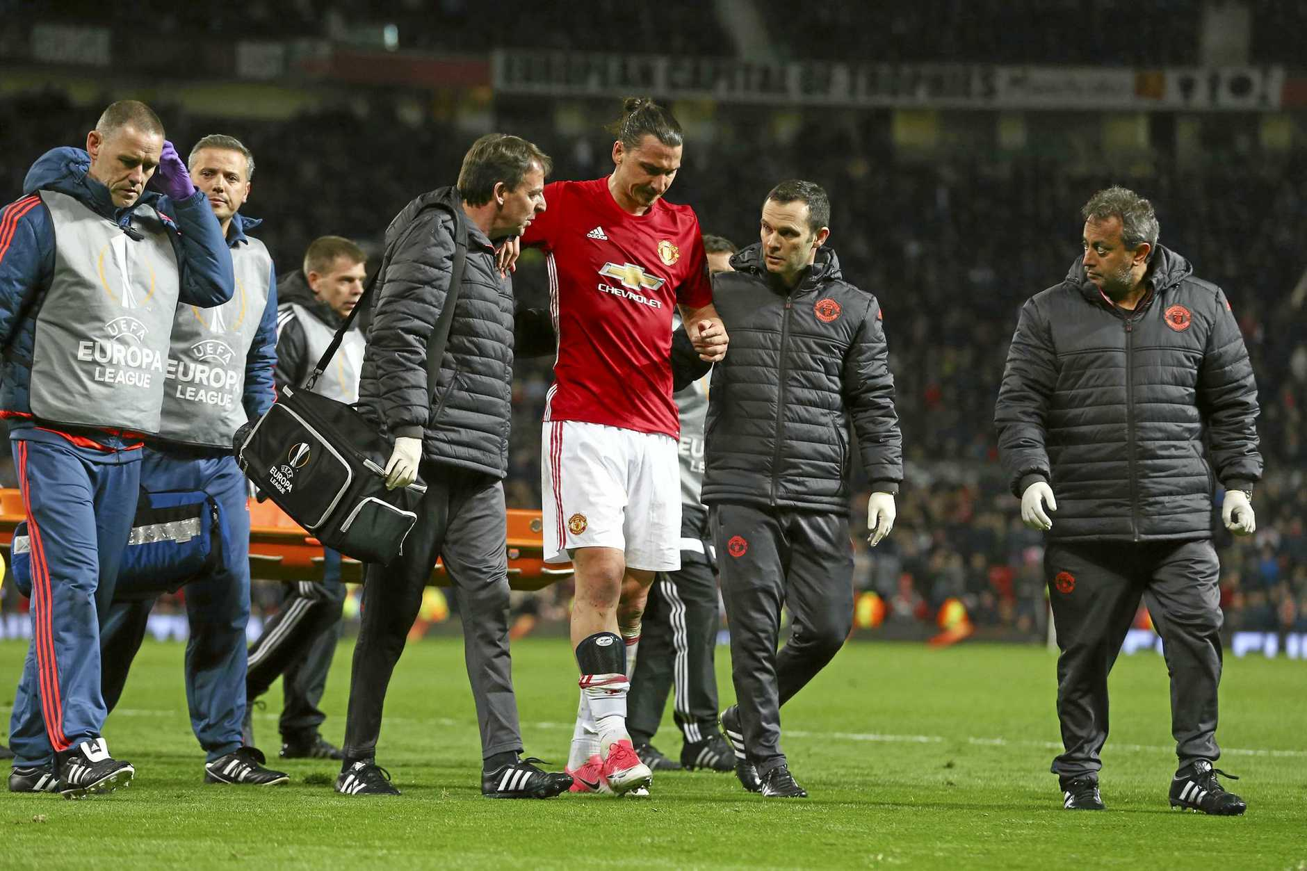 Manchester United's Zlatan Ibrahimovic, center, leaves the field with an injury during the Europa League quarterfinal second leg soccer match between Manchester United and Anderlecht at Old Trafford stadium, in Manchester, England, Thursday, April 20, 2017. (AP Photo/Dave Thompson)