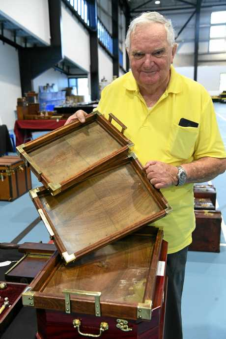 ANTIQUES: Allan Lawson with a set of brass handled trays from a bank in Edinburgh.