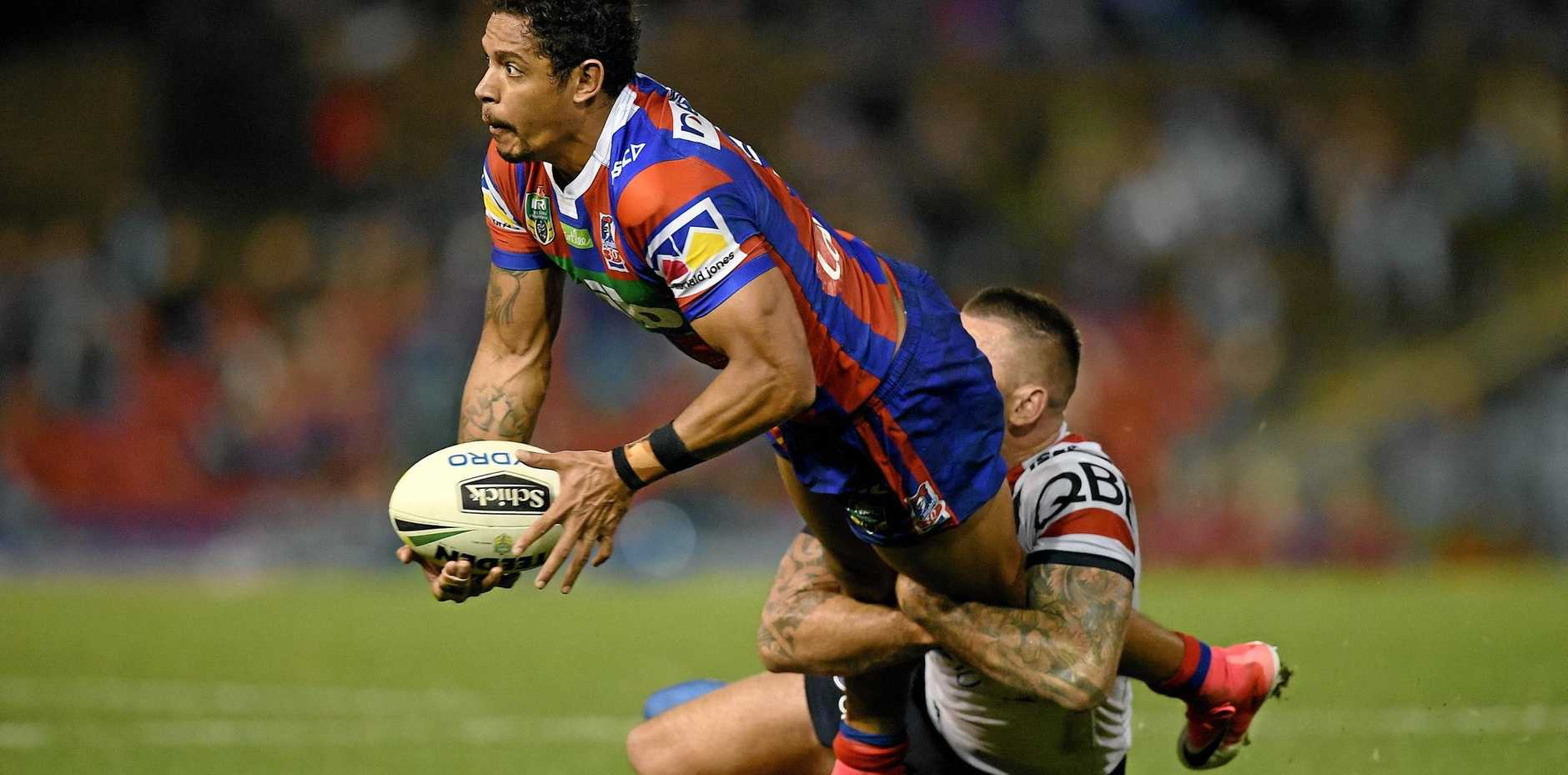 Dane Gagai of the Knights is tackled by Shaun Kenny-Dowall of the Roosters.