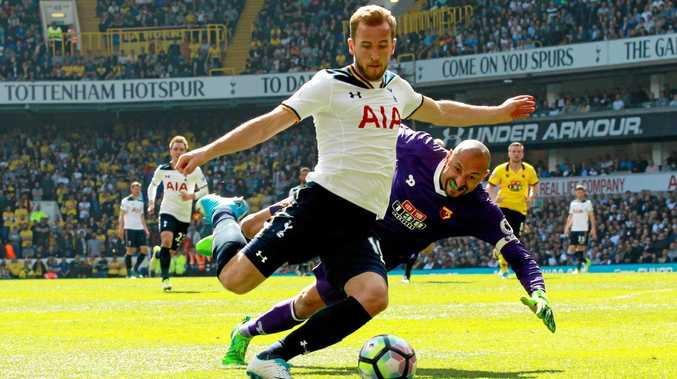Spurs striker Harry Kane rounds Watford goalkeeper Heurelho Gomes.
