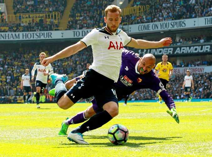 Spurs striker Harry Kane rounds Watford goalkeeper Heurelho Gomes.