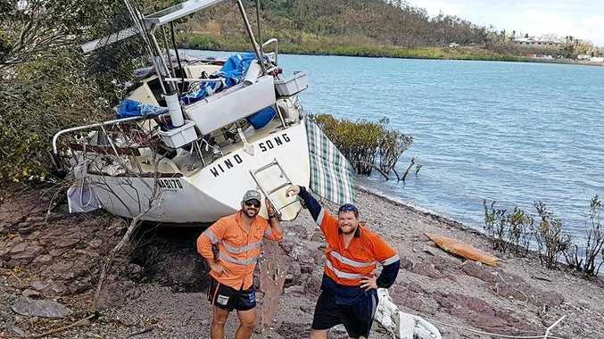 Ricky Falzon helping out his mate Brendan Trembath with Wind Song in the Whitsundays after Cyclone Debbie.