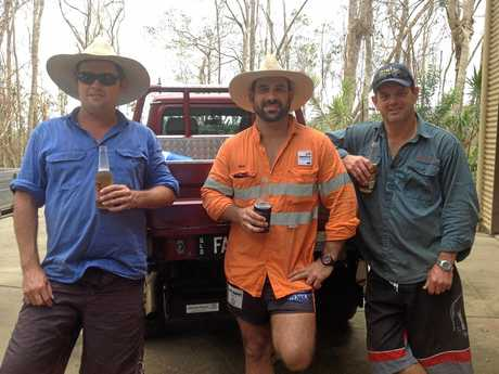 Ricky Falzon (centre) helping out in the Whitsundays after Cyclone Debbie.