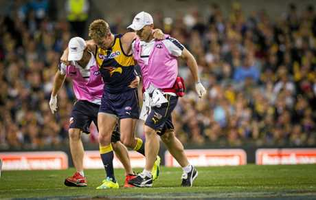Sam Mitchell of the West Coast Eagles leaves the field injured last week.