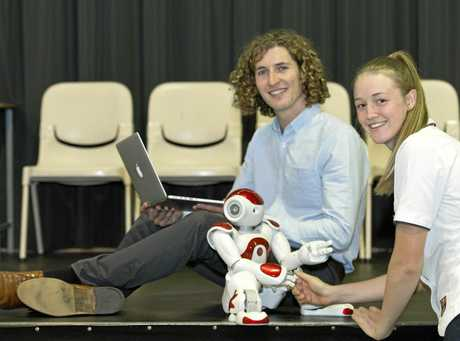 Jonathan Kingsley from Brainary Interactiv shows St Joseph's College Year 12 student Shana Stokes NAO the humanoid robot , Friday, April 21, 2017.