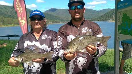 Terry Allwood (right) and his father Paul show their catches at Borumba Dam the day after Terry found a submerged car with his electronic depth sounder.