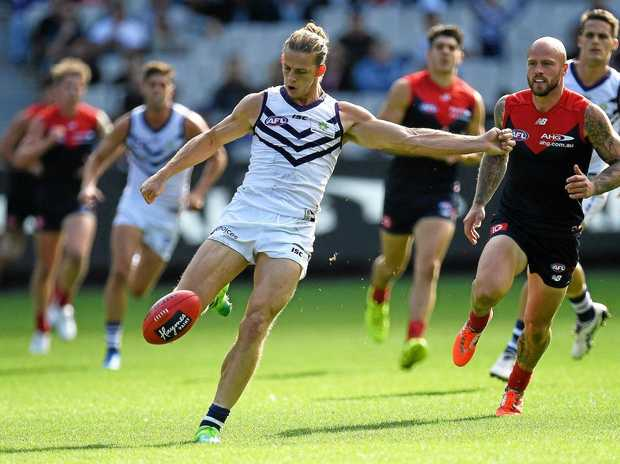 Nat Fyfe of the Dockers gets a kick away.