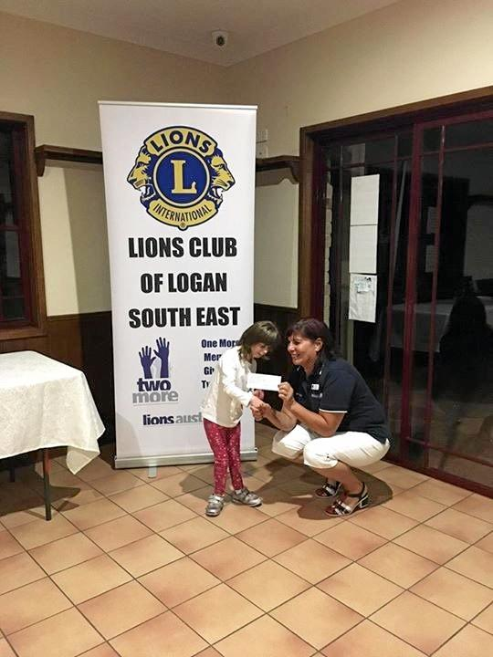 Chloe Scott received a donation from the Lions Club of Logan South East.