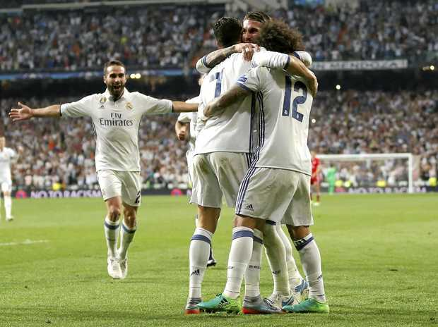 Real Madrid players celebrate after scoring against Bayern Munich.