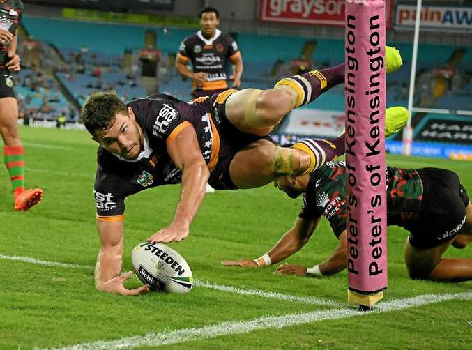 Corey Oates of the Broncos scores a try against the Rabbitohs.