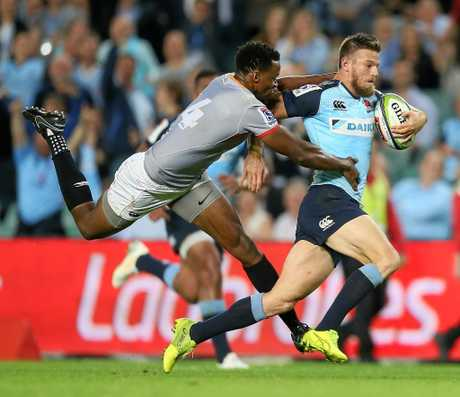 Rob Horne of the Waratahs beats the tackle of Wandile Mjekevu of the Southern Kings.
