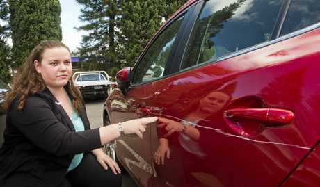 SENSELESS DAMAGE: Tracey Browne points out the damages to her car.